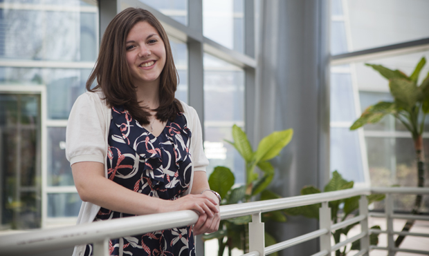 Andrea Jaffe, who is earning her master's degree this month, is seen inside Academic Building A. Jaffe has spent the year working as a graduate assistant in the University's Office of Internal Audit.