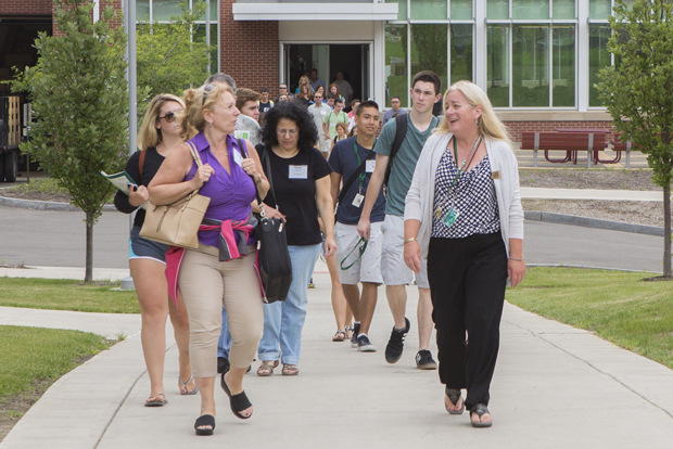 Kim Jaussi, right, associate professor in the School of Management and Dickinson faculty master, leads a group of students and parents through the residential community during a summer tour.
