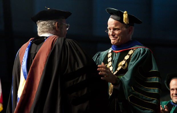 President Harvey Stenger greets Steve Karmen following the composer's moving Commencement address on May 20.