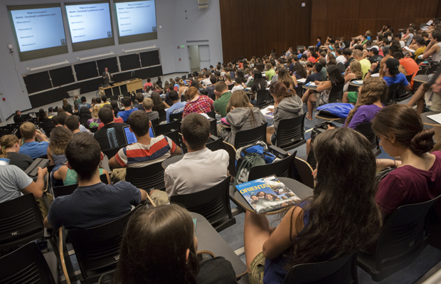 Incoming freshmen listen as Professor Florenz Plassmann discusses economics during a