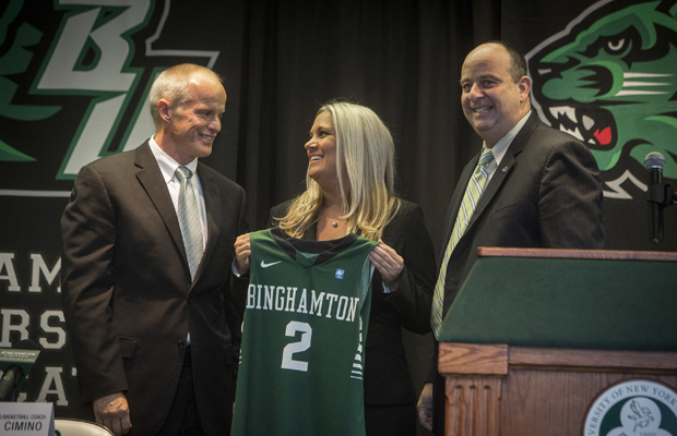 Linda Cimino is flanked by President Harvey Stenger (left) and Athletic Director Patrick Elliott as she shows off a Binghamton jersey during a news conference on April 11, at which she was announced as the new Binghamton University women's head basketball coach.