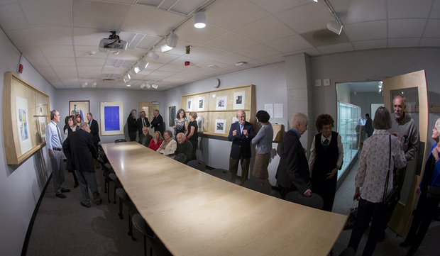 A crowd gathers in the Kenneth C. Lindsay Study Room of the University Art Museum for a ceremony dedicating the room on Oct. 11.