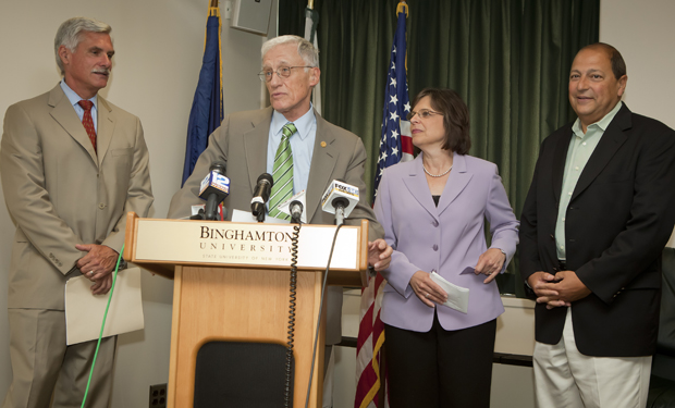 Binghamton University President C. Peter Magrath, speaks during a news conference announcing an articulation agreement and memorandum of understanding with SUNY Upstate Medical University at the Couper Administration Building on July 25. SUNY Upstate Medical President David Smith, left, state Assemblywoman Donna A. Lupardo and state Sen. Thomas Libous, right, also took part in the event.