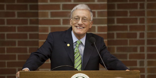 C. Peter Magrath, seen here addressing the Binghamton University Forum, will continue to serve as University president while the presidential search continues. Magrath said he is