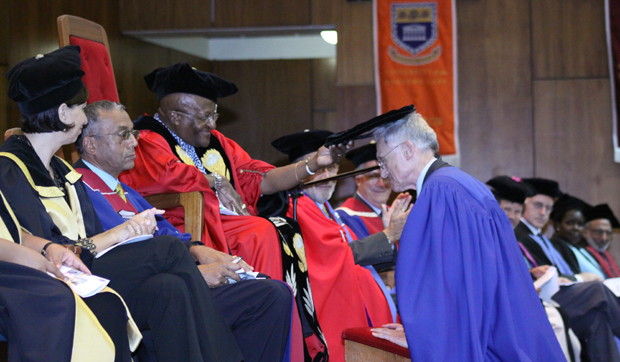 Archbishop Emeritus Desmond Tutu confers an honorary doctorate on Interim President C. Peter Magrath at the University of the Western Cape (UWC) in South Africa on March 14. While president of the University of Missouri in the 1980s, Magrath formed an affiliation with UWC.