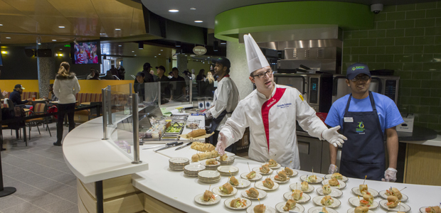 Executive Chef Geraldo Calderon offers a variety of sandwiches during the soft opening of the new Binghamton University MarketPlace at the University Union.
