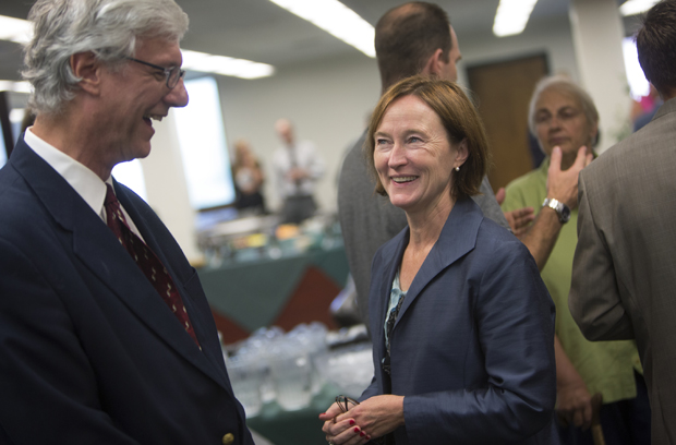Harpur College Dean Anne McCall speaks with Andrew Scholtz, chair of the Classical and Near Eastern Studies Department, during a welcome reception in the Harpur's Dean Office Suite on Aug. 28.