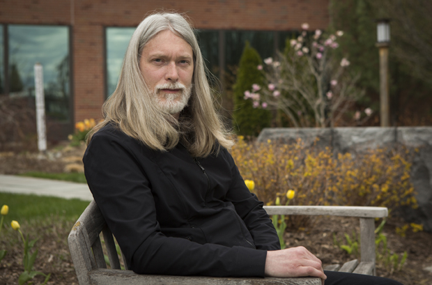 Tom McDonough, chair of the Art History Department seen here in the Memorial Courtyard, will serve as a visiting associate professor at Harvard University this fall.