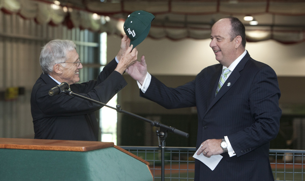 President C. Peter Magrath gives a Binghamton University cap to Patrick Elliott, the University's new director of athletics. Elliott, who has been director of athletics at Saint Peter's College, will succeed James Norris on Nov. 14.