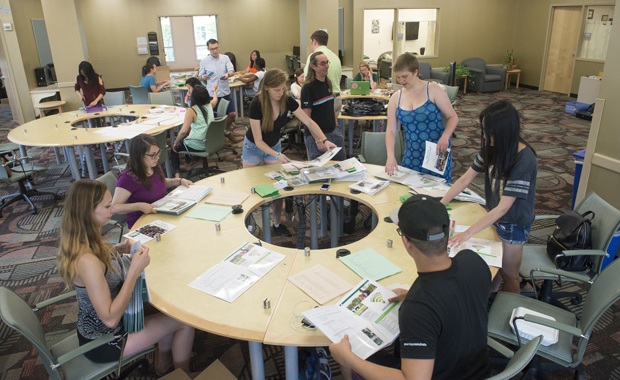 Orientation advisors prepare information packets for incoming students at the Chenango Champlain Collegiate Center. Orientation for Harpur College and professional-school freshmen takes place in July.