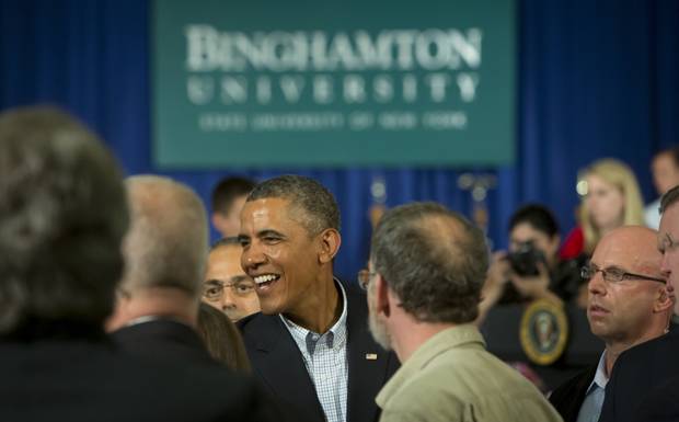President Obama shakes hands with audience members at the conclusion of a town hall meeting held Aug. 23 in the Mandela Room at Binghamton University.