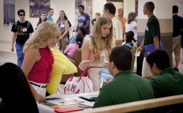 Debbie Juran of Binghamton, and daughter Taylor Juran, an incoming freshman studying pre-health and biology, check in for the first session of Harpur College orientation in the Tillman Lobby of the University Union.