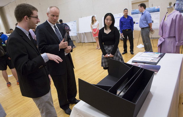 Glenn Pepe and Jun Han, technical and theatre design majors, discuss their work with President Harvey G. Stenger during a poster session held during Research Days in the Mandela Room on April 19.