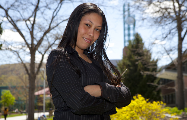 Yahaira Rivera, seen near the campus Peace Quad, is one of thousands who will play a role in Commencement weekend. Rivera will receive a master's degree in education.