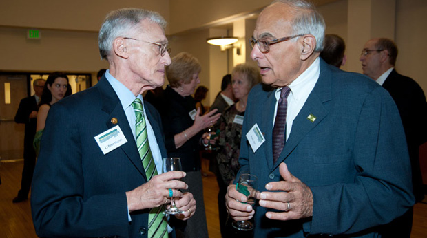 Interim President C. Peter Magrath talks with Ferris Akel during the School of Management's 40th Anniversary Gala on Oct. 9 in the Mandela Room of the University Union.