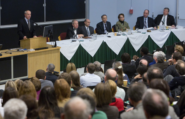 Binghamton University's vice presidents, seated at table, listen as President Harvey Stenger delivers the State of the University address on Jan. 22 in Lecture Hall 1.