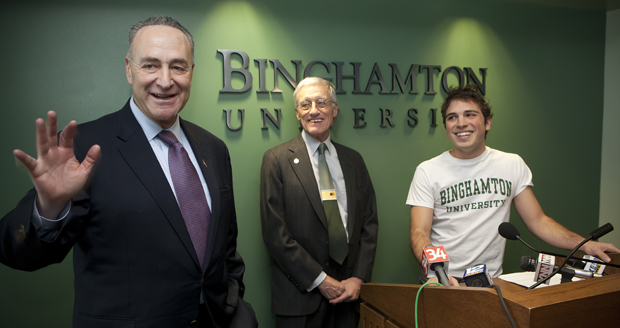Interim President C. Peter Magrath and Binghamton University student Santino DeAngelo watch as Sen. Charles E. Schumer discusses tuition tax credits Jan. 20 at the Admissions Office in Academic Building A.
