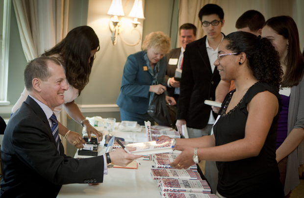 Gary Shapiro '77, president and chief executive officer of the Consumer Electronics Association (CEA), speaks with Coralie Brutus, an industrial and systems engineering major from Stony Brook, during a book signing after Shapiro spoke to the Binghamton Forum on March 31 at Traditions at the Glen.