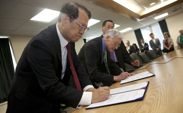 President C. Peter Magrath and Academy of Korean Studies President ChungKil Chung sign agreements linking the two schools. Binghamton University will receive a five-year, $1 million grant from the Academy of Korean Studies that will help support research and education in Korean studies.