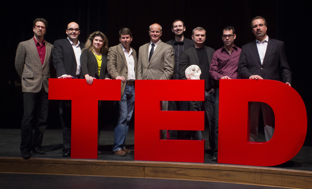 President Harvey Stenger, center, is surrounded by the speakers from the third annual TEDx Binghamton University conference. From left are: John Boyer, Justin Garcia, Michelle Thaller, Daniel Drezner, Alexander Macris, Joshua Harker, Kyle Cranmer and David Ferrucci.