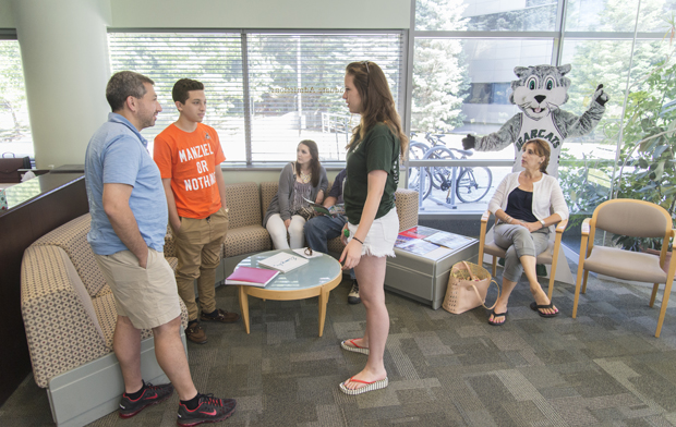 Tour guide Gabrielle Maire, a double major in integrative neuroscience and music, prepares to give a campus tour last month.