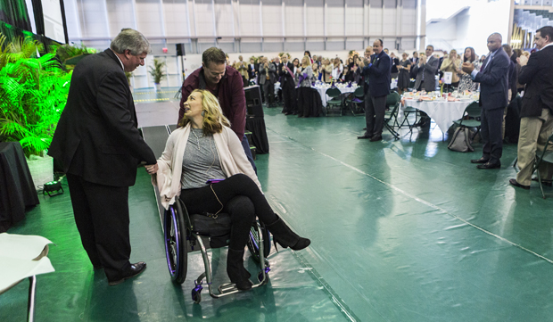 Olympic swimming great Amy Van Dyken-Rouen shakes hands with Brad Manchester, Binghamton Bearcats Athletic Association vice president, after her speech at the 11th Annual Celebrating Women's Athletics Luncheon on Feb. 22 in the Events Center.