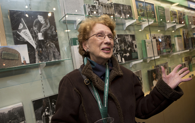 Ellen Thurston '54 stands in front of a picture of her taken when was a Harpur College undergraduate. Thurston was among the alumni who attended the Harpur Quad and Wall of Excellence dedication.