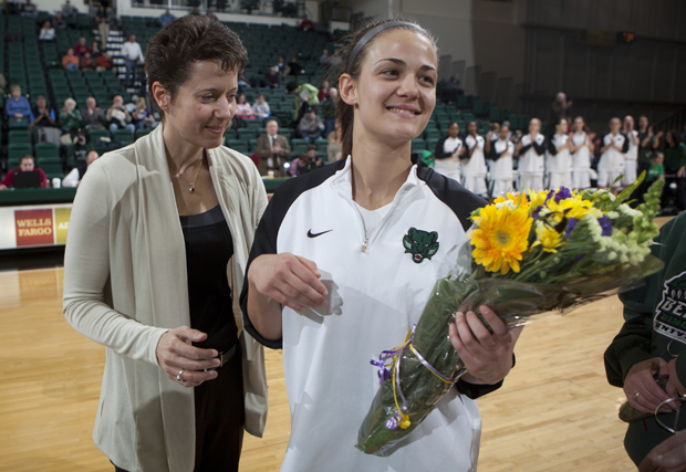 Head coach Nichole Scholl and Binghamton University fans and players honor senior guard Jackie Ward before the start of her final home game Feb. 23.