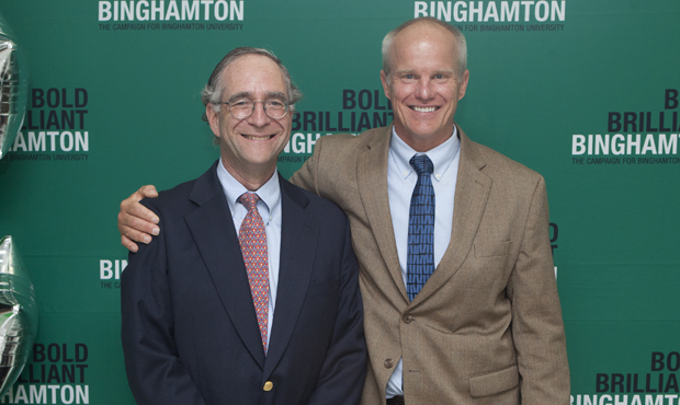 Campaign chair Paul Turovsky '73, left, and President Harvey Stenger announced July 19 at the Couper Administration Building that the <em>Bold.Brilliant.Binghamton </em>campaign raised $101,219,372 to support academic excellence, faculty research and other University needs.