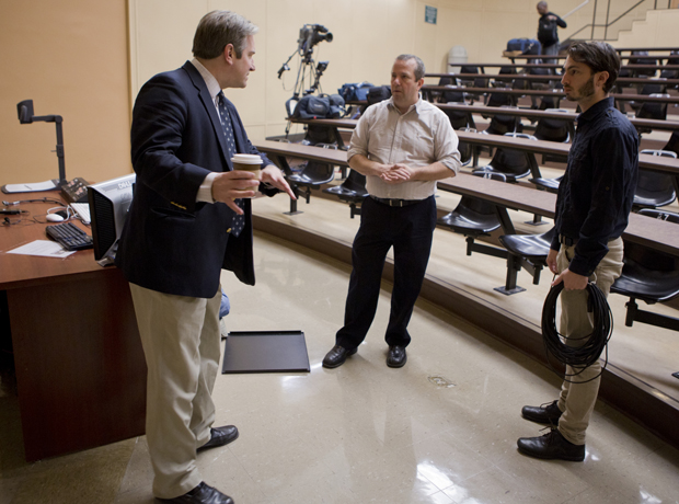 Douglas Bradburn, left, associate professor of history, talks with members of the C-SPAN crew before his Politics and Society in Colonial America class was filmed by the network last November.