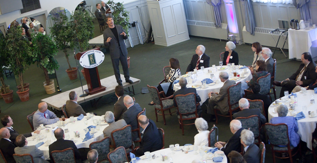 Tim Green discusses literacy and youth at a Binghamton University Forum event at the Binghamton Club on Sept. 23. Green, an author, lawyer and former football player, has talked about the importance of reading to more than 100,000 students across the country.