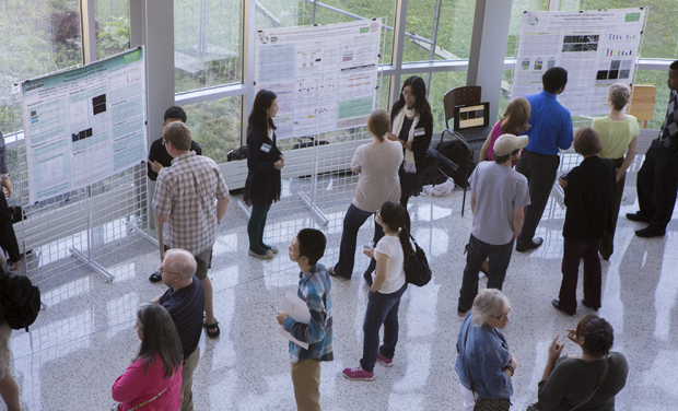 Binghamton University students and faculty members take part in a Howard Hughes Medical Institute (HHMI) poster session held last summer in the Innovative Technologies Complex. Binghamton University has received a five-year, $1.2 million grant from HHMI.