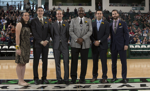 From left: Leah Truncale '02, basketball; Rory Quiller '07, track and field; Graham Munro '06, soccer; Glenn McIver '78, basketball; David Holmes '07, swimming; and Scott Diamond '11, baseball; receive an ovation from the fans at the Binghamton-Navy basketball game prior to being inducted into the Binghamton University Athletics Hall of Fame.