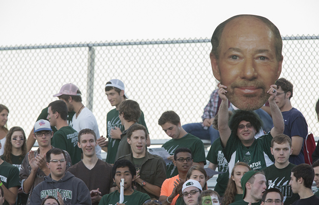 A student holds up a cut-out of sportscaster (and alum) Tony Kornheiser's head during the men's soccer game vs. UMass L