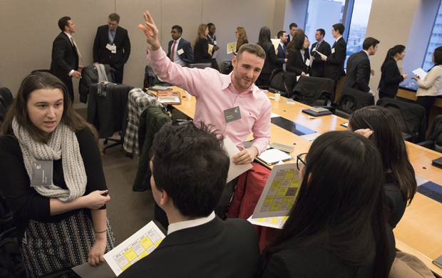 Alumni Tara Finkelstein '15 and Nick Delvin '14 speak with Binghamton University students who visited Ernst & Young in New York City during Binghamton in the City events that took place Jan. 10-13.