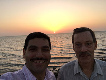 Ron Miles and Mohammad Younis in Saudi Arabia at sunset