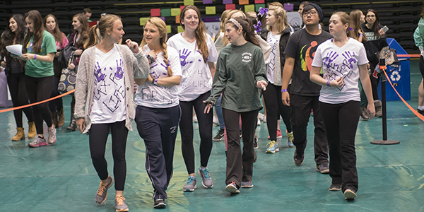 A team from a past Relay for Life in the Binghamton University Events Center walks to raise funds for to support cancer patients.