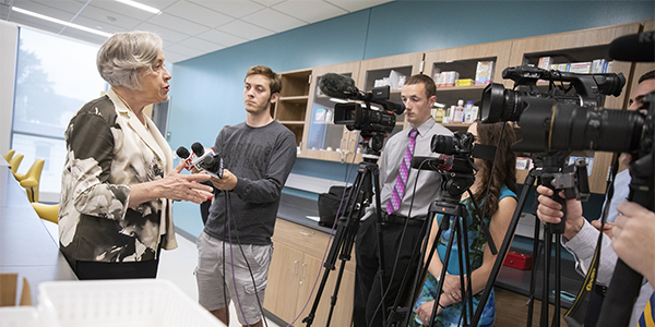 School of Pharmacy and Pharmaceutical Sciences Founding Dean Gloria Meredith speaks to the media on the first day of classes held at the brand-new school.