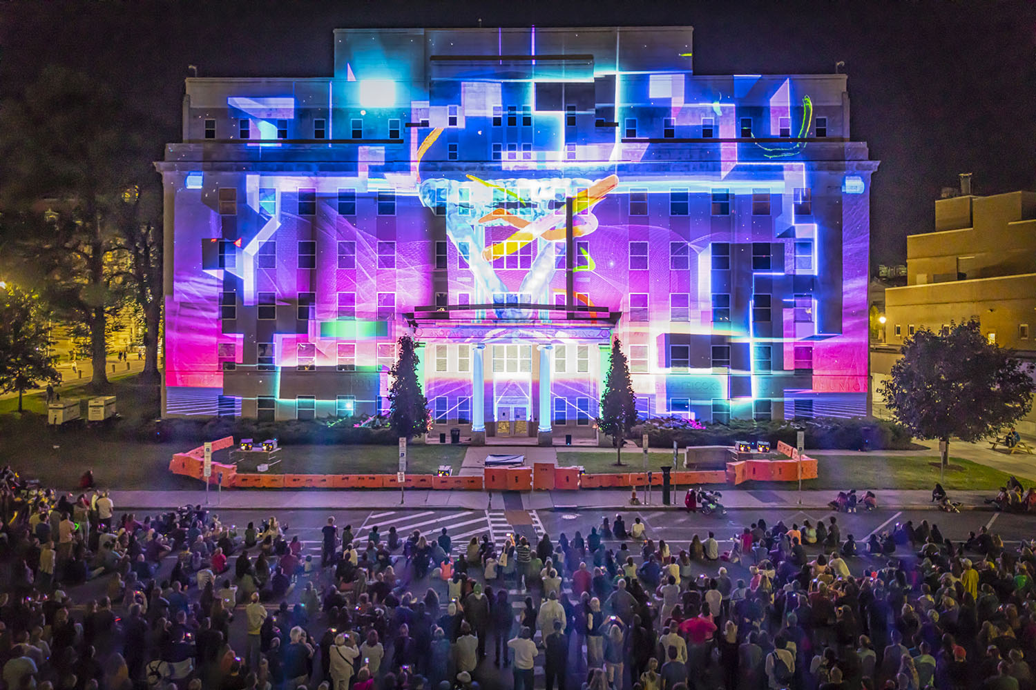 The LUMA Projection Arts Festival features a variety of colorful light shows projected on top of downtown Binghamton buildings.