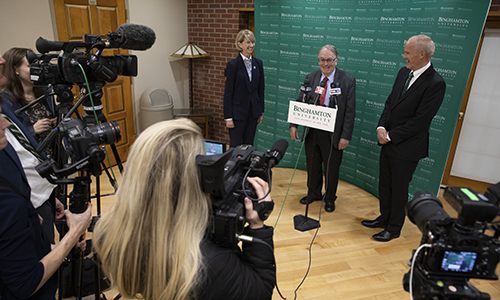 Distinguished Professor M. Stanley Whittingham, flanked by SUNY Chancellor Kristina Johnson and Binghamton University President Harvey Stenger, responds to media questions prior to the ceremony and reception honoring him for winning the Nobel Prize in Chemistry.