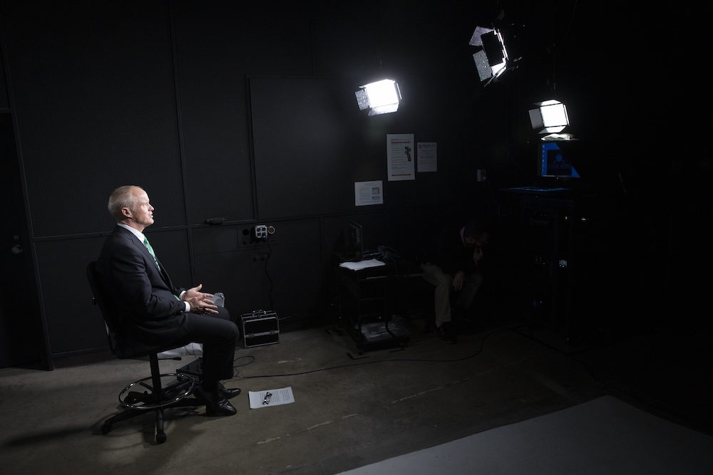 Binghamton University President Harvey Stenger using the ReadyCam system that can livestream high-definition video to network television.