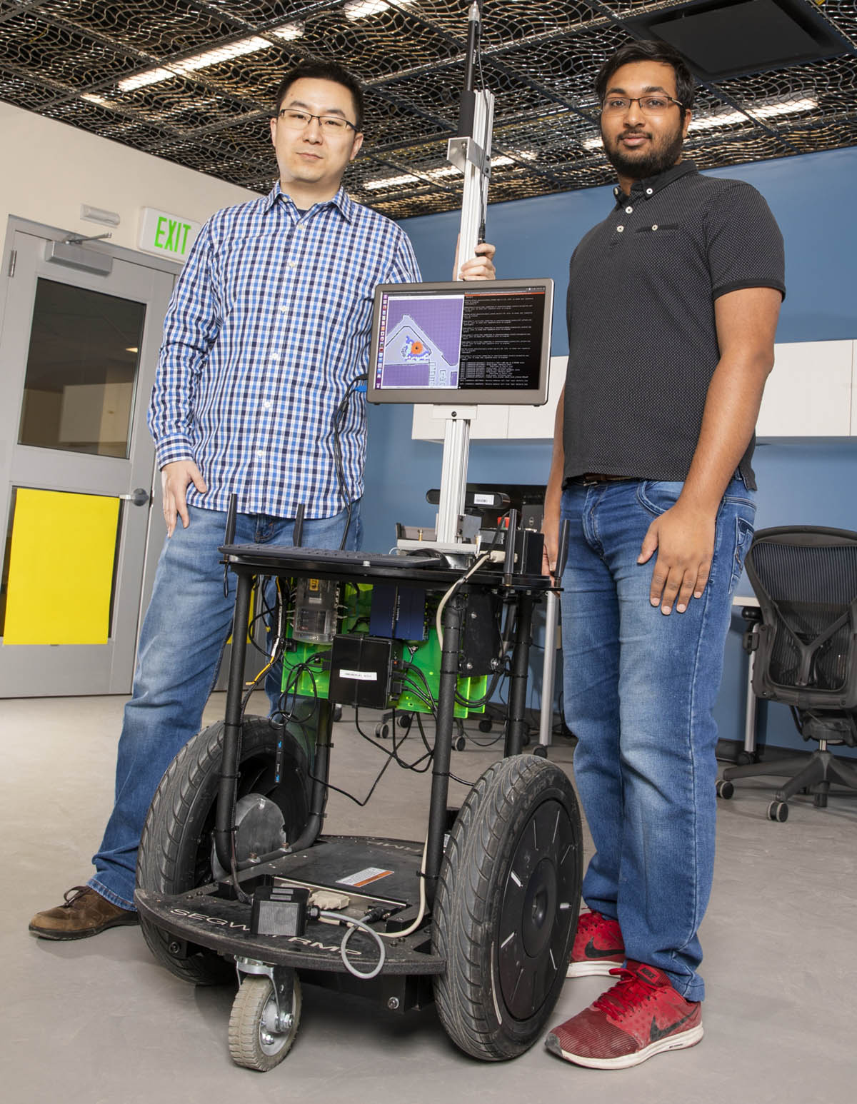 Assistant Professor Shiqi Zhang, left, and PhD student Kishan Chandan developed the ARROCH system alongside others at Zhang's Autonomous Intelligent Robotics Lab.