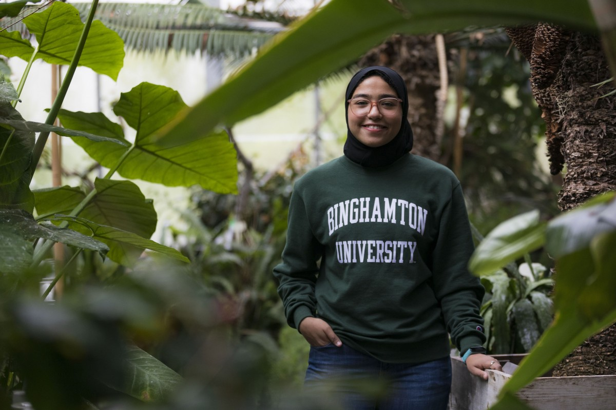 Hagar K. Soliman, a graduate student in the Ecology, Evoluntion and Behavior Program in the Dept. of Biological Sciences, photographed, May 5, 2021 at the E.W. Heier Teaching and Research Greenhouses in Science III.