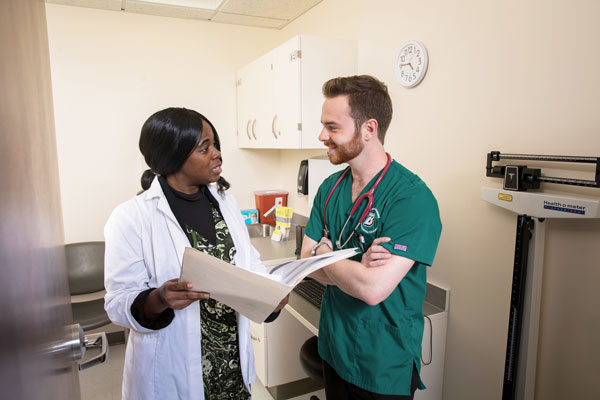 Afua Baidoo-Davis, an adjunct clinical instructor at the Decker School of Nursing, shown here with Baccalaureate Accelerated Track student Julien Deshler, encourages students to treat patients as they would want to be treated themselves.