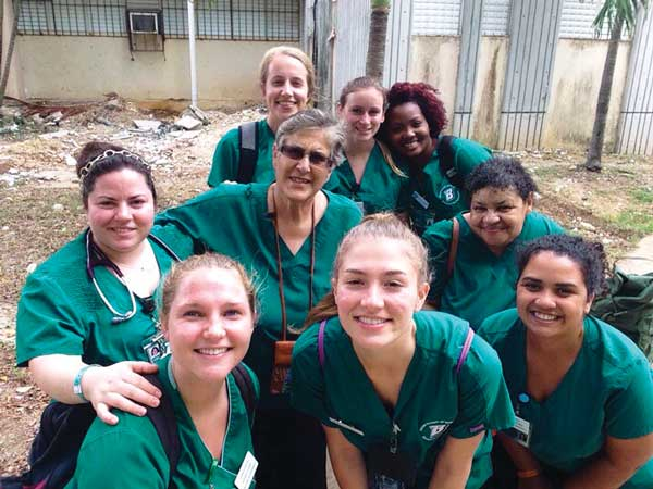 For more than a decade, Clinical Associate Professor Laura Terriquez-Kasey, center with glasses, has taken undergraduate students to the Dominican Republic to provide healthcare. This is the group from 2016, which included Decker Clinical Instructor Socorro Osorio, center row, right.
