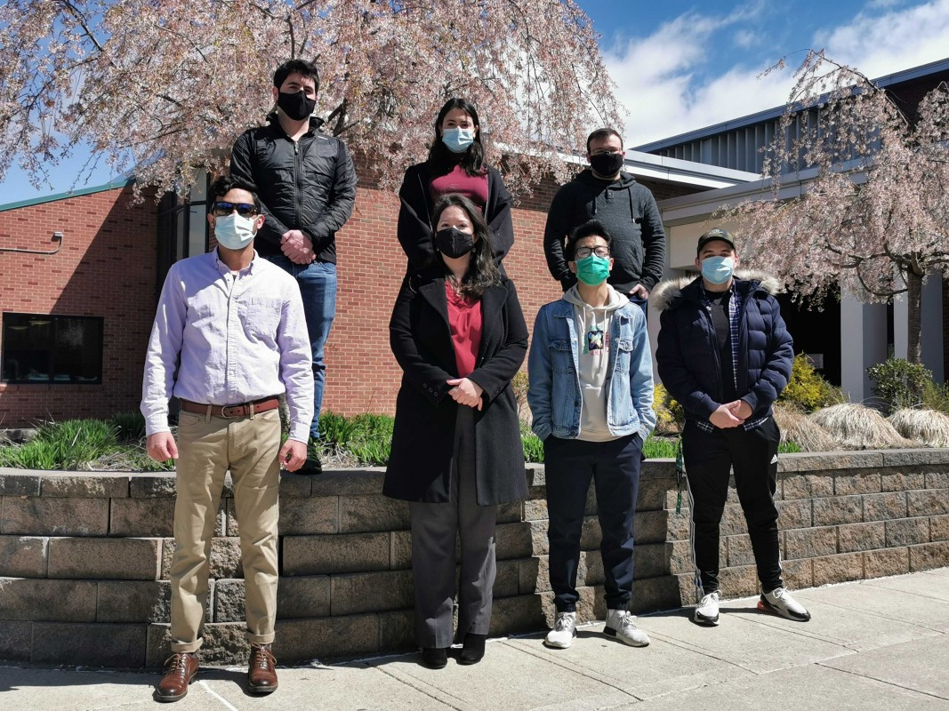 Binghamton University Assistant Professor of Physics Ana Laura Elías (center front) and members of her lab.