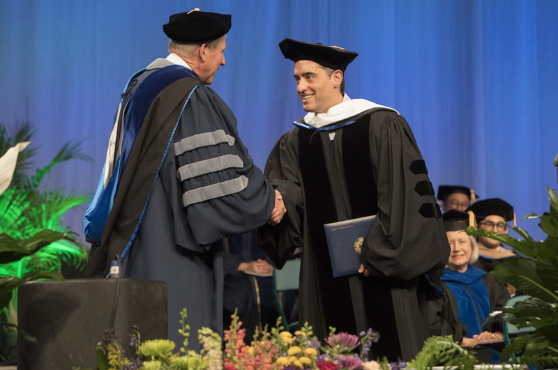 Nathan Englander'91 is greeted by Provost Donald Nieman during the Graduate School Commencement ceremony on May 19.