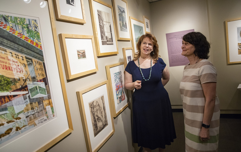 Diane Butler, Binghamton University art director, left, and Pamela Smart, associate professor of art history, have helped students find ways to engage with University-related art.