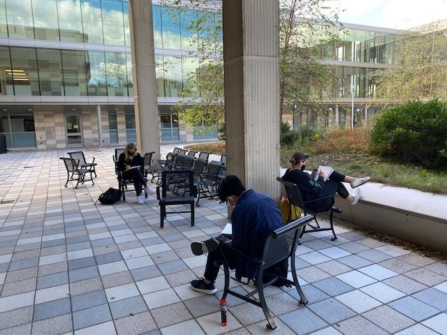 Members of Alexandra Davis' drawing class work on an assignment outdoors.