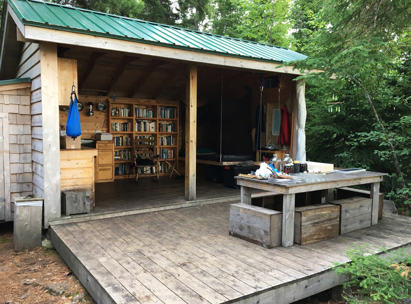 Rabbit Island features a small, three-walled cabin with a bed, kitchen and bookshelves.